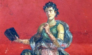 A detail from a fresco taken Monday, November 6, 2000, shows the roman divinity Calliope, Muse of epic poetry, portrayed on the walls of the recently rediscovered ruins of what is believed to be the ancient guest house of Roman Pompeii, Italy. Excavations for an extension of the Naples-Salerno highway brought light on a 1000 square meters construction, forgotten since its first discovery in 1959. Archeologists believe that these frescoes, of extreme importance for their beauty and technique, could prove that the Roman Pompeii was not declining in importance when covered by ashes in 79 a.D. (AP Photo/Pasquale Sorrentino)